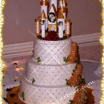 Buttercream icing with a trellis effect and gold dragees .  The is a castle topper decorated by the bride and placed on top of my cake, stairways  around the sides are all cake.